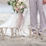 We Do bride and groom on beach in emerald isle, nc