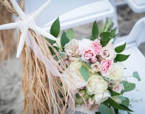 08-emerald-isle-beach-wedding-ceremony-chair-flowers