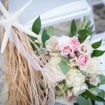 08-emerald-isle-beach-wedding-ceremony-chair-flowers