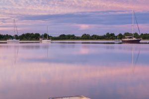 Boats on Taylor Creek at dawn in Beaufort.