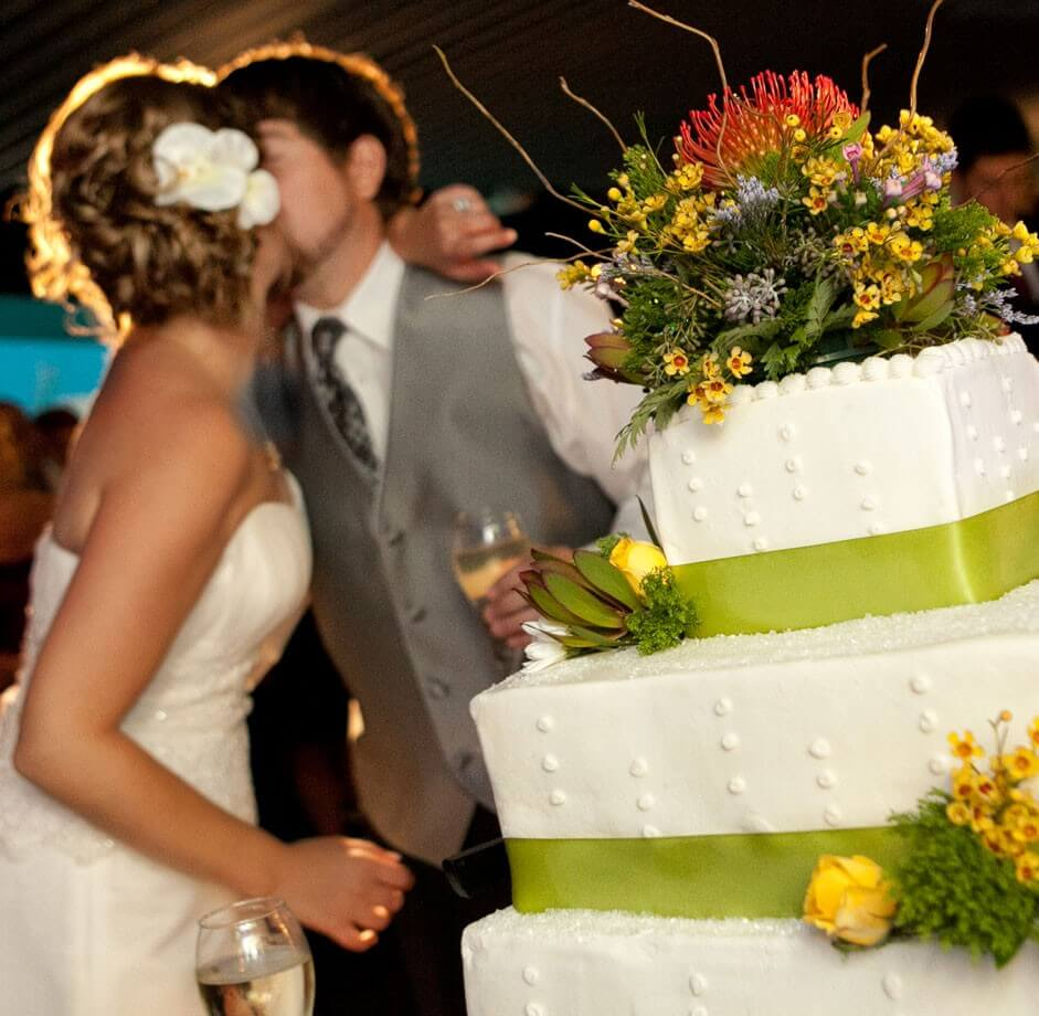 Emerald Isle Couple Kissing at Reception