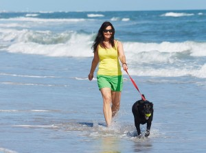 Lady with Dog on Emerald Isle Beach