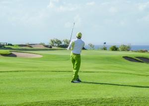 Man Playing Golf in Emerald Isle, NC