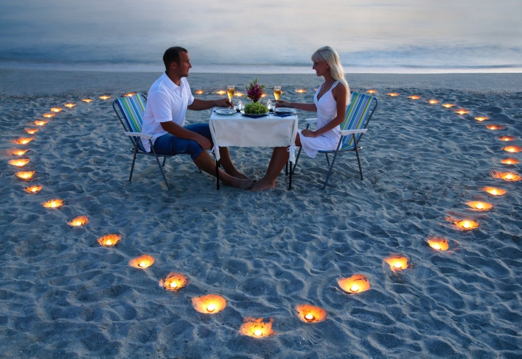 Couple with Heart Candles on Beach