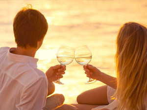 Couple with Wine Glasses on Beach