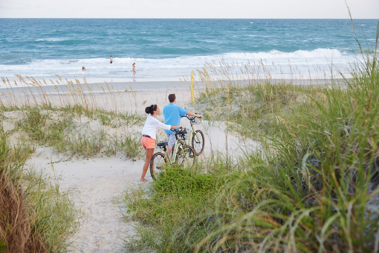 Couple Riding Bikes on Beaches in Emerald Isle NC