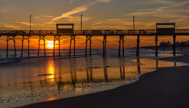 View of sunset behind Bogue Inlet Pier in Emerald Isle
