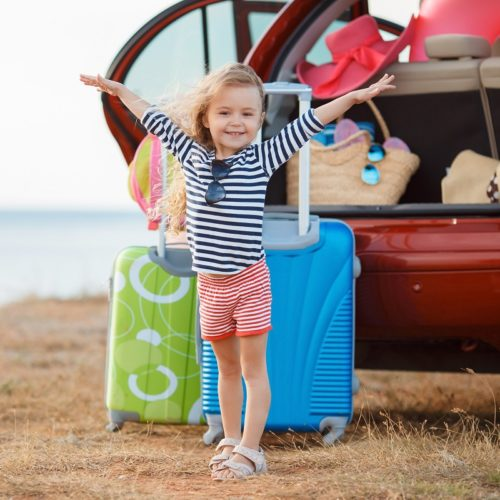 Girl Traveling in Packed Car