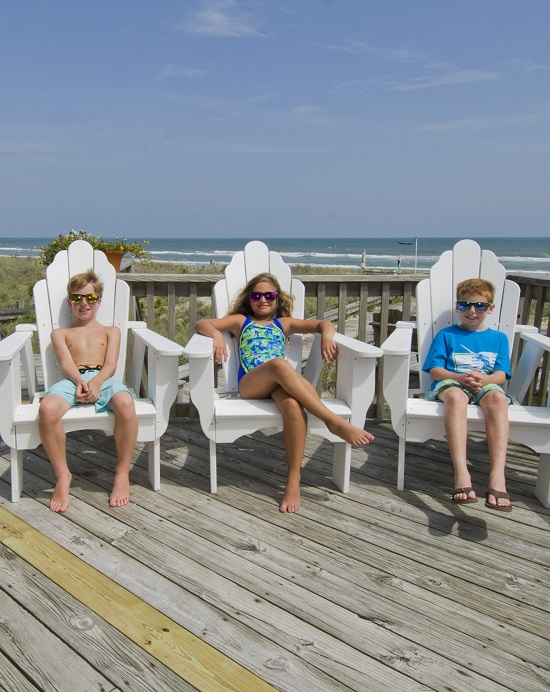 Kids Lounging in Deck Chairs at Oceanfront Vacation Rental in Emerald Isle, NC