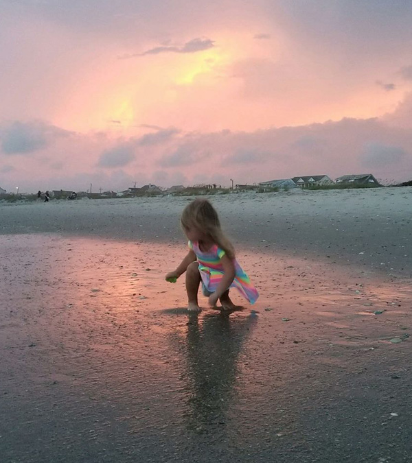 Best Shelling Beaches in North Carolina's Outer Banks - Kid looking for shells
