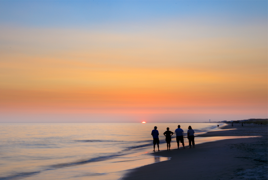 Watch a sunset at the beach in Emerald Isle