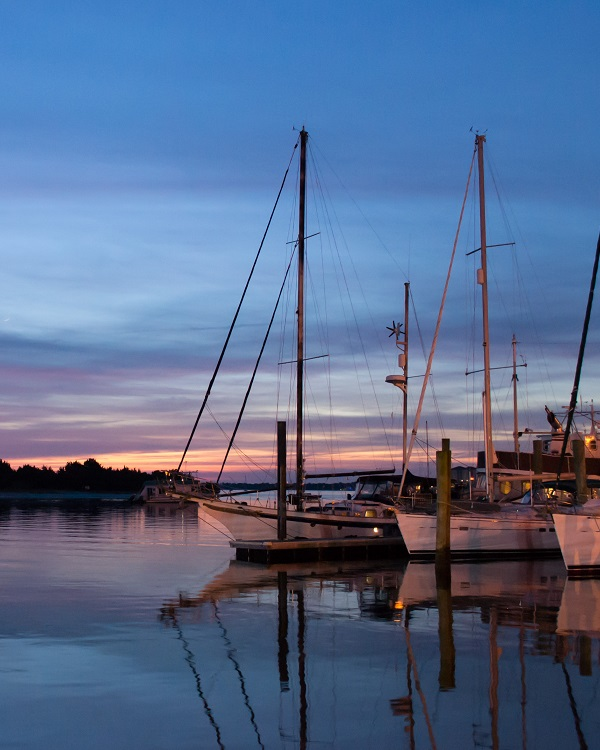Amazing sunset with sailboats in Beaufort, NC harbor