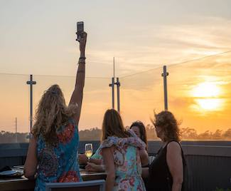 Enjoy drinks on the rooftop at Caribsea on your fall girls getaway to Emerald Isle