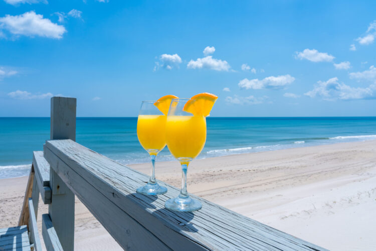 Enjoy mimosas on the beach during your fall girls getaway