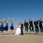Wedding Party on Beach in Emerald Isle Groom and Bridge Kiss