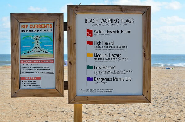 beach-warning-flag-rip-current-599x397