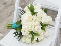 Bouquet on chair at beach
