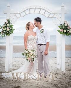 Wedding Couple under Arch at Emerald Isle Beach Wedding