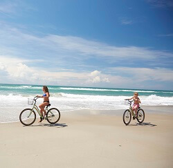 emerald-isle-kids-riding-bikes-on-beach-250x243