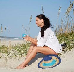 emerald-isle-woman-relaxing-on-beach-250x243