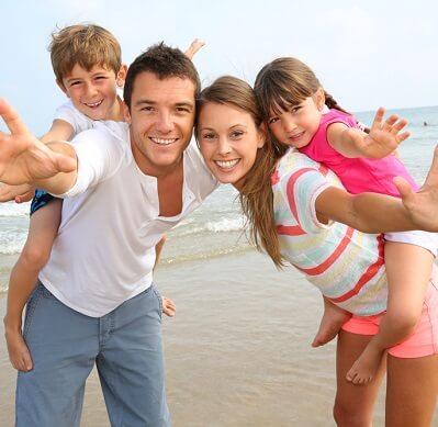 family-on-beach-399x389