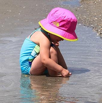 Girl playing on beach in Emerald Isle NC