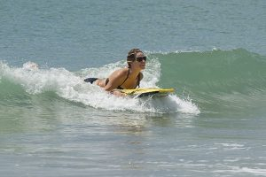 Girl on board surfing in Emerald Isle NC